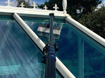 conservatory cleaning with extending arm brush