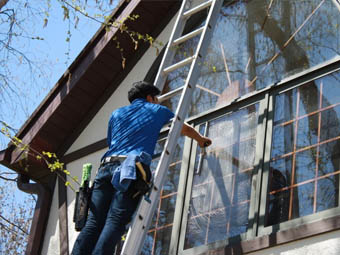 high rise domestic window cleaning using ladder