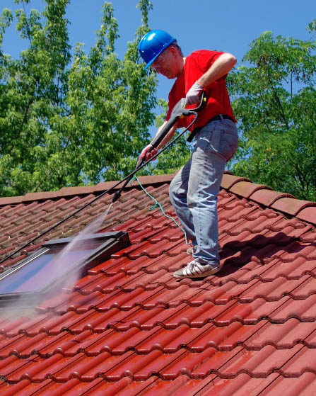 pressure cleaning technician on roof